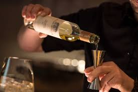 A Sommelier pouring wine